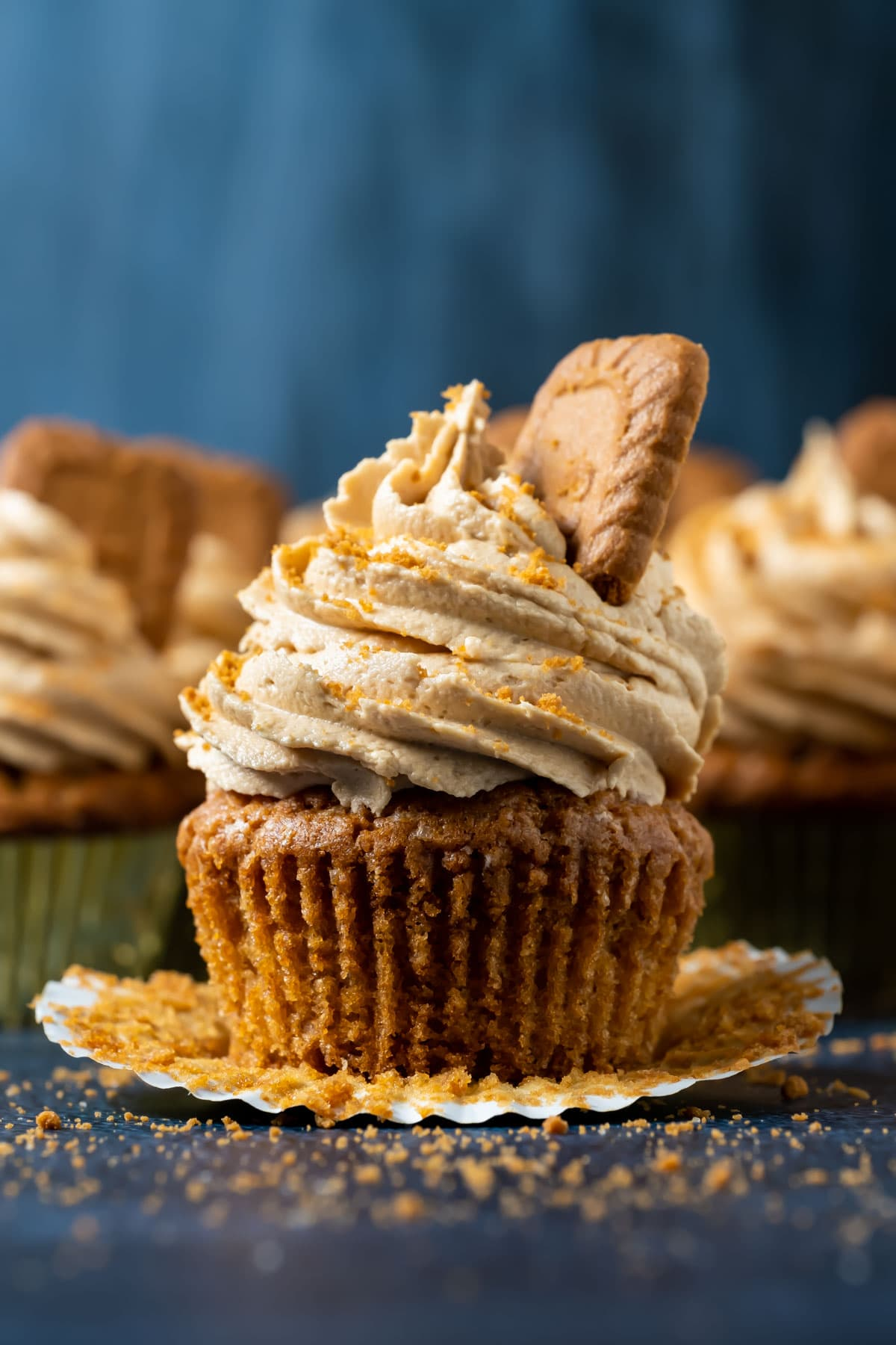 Biscoff cupcake with the liner pulled down.