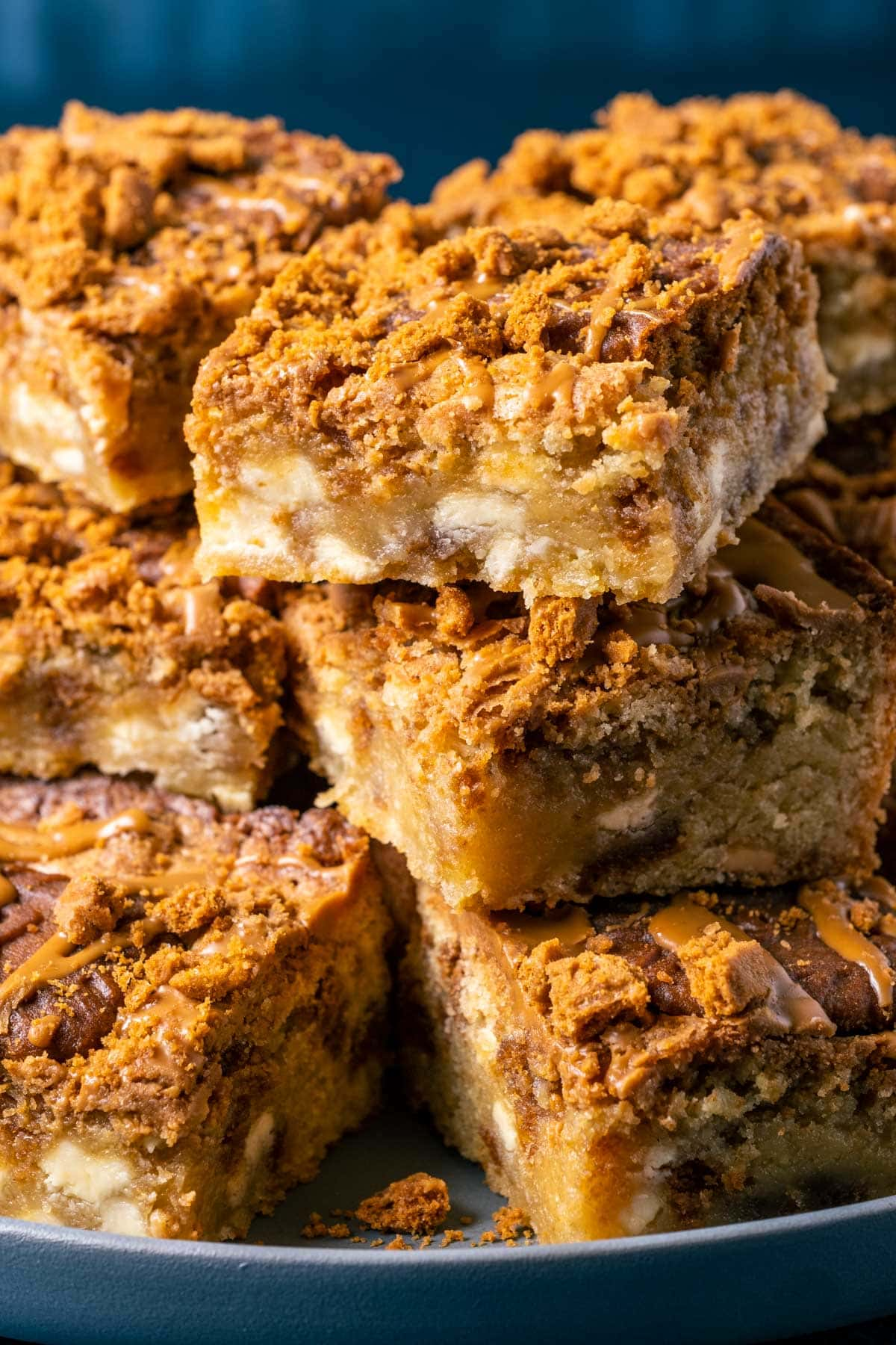 Biscoff blondies stacked up on a plate.