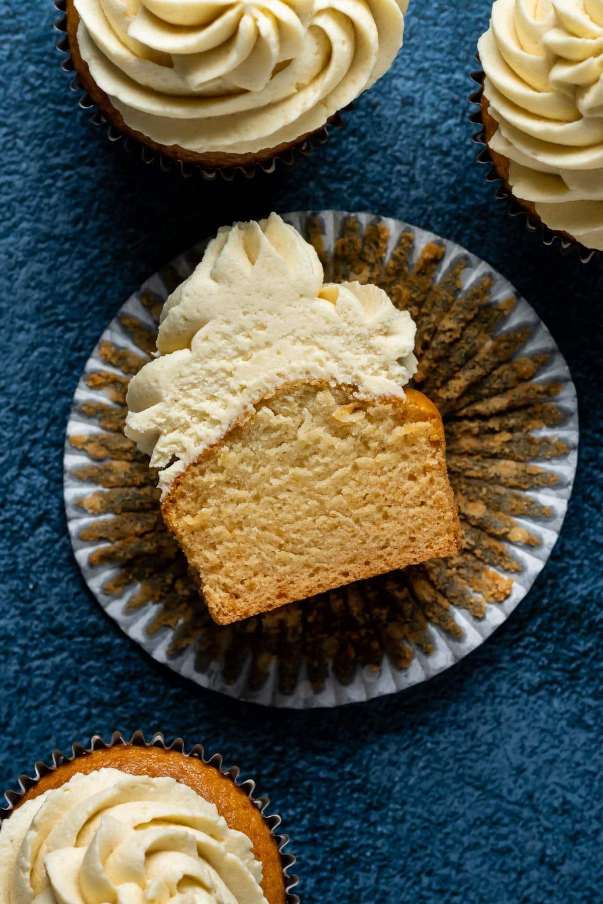 Eggless vanilla cupcake cut in half.